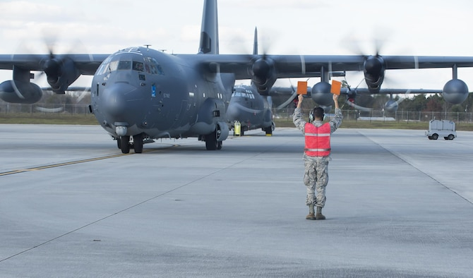 Airman 1st Class Jonathan Marquez, a 71st Rescue Squadron crew chief, marshals in an HC-130J Combat King II Dec. 11, 2015, at Moody Air Force Base, Ga. The aircraft is the 2,500th C-130 manufactured by Lockheed Martin Corp. in Marietta, Ga. (U.S. Air Force photo/Senior Airman Ceaira Tinsley)