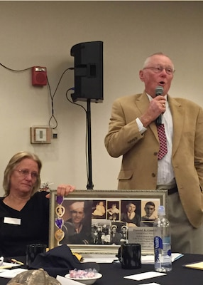 Dale Costill speaks to nearly 200 family members about his brother, who was lost during World War II in Pearl Harbor. Costill, looking for answers, attended a government briefing hosted by the Defense POW/MIA Accounting Agency, in Portland, Maine, Nov. 14