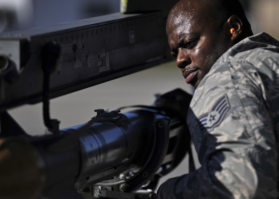 An aircraft armament Airman with the 77th Aircraft Maintenance Unit at Shaw Air Force Base, S.C., begins to unload a missile Dec. 8, 2015, on the flightline at Tyndall AFB, Fla. Airmen from Shaw were at Tyndall for the 53rd Weapons Evaluation Group's Weapons System Evaluation Program and Checkered Flag 16-1. (U.S. Air Force photo/Senior Airman Sergio A. Gamboa)