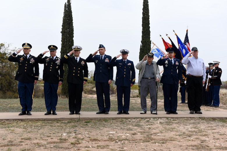 Past and present service members, representing each branch of the military, salute during the Wreaths Across America at the Belvedere Cemetery in San Angelo, Texas, Dec. 12, 2015. The salute was to honor deceased veterans. (U.S. Air Force photo by Airman Chase Sousa/Released)