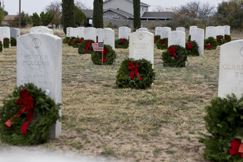 Wreaths from the Wreaths Across America ceremony lay at the Belvedere Cemetery in San Angelo, Texas, Dec. 12, 2015. The ceremony was to honor and give thanks to all deceased veterans. (U.S. Air Force photo by Airman Chase Sousa/Released)