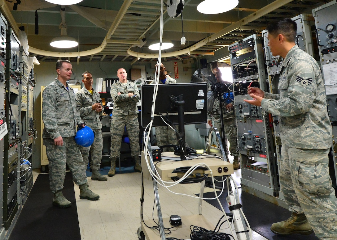 Senior Airman Jason Yumen, a radio frequency technician for the 169th Air Defense Squadron, briefs 15th Wing and Hawaii Air National Guard leaders on the mission of the 169th ADS during a tour of the Mount Kaala Air Force Station, Hawaii, Dec. 4, 2015. With an elevation of roughly 4,000 feet, Mount Kaala Air Force Station is the heist point on the island of Oahu. (U.S. Air Force photo by Tech. Sgt. Aaron Oelrich/Released)