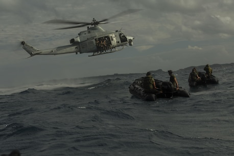 Marines with the Maritime Raid Force, 31st Marine Expeditionary Unit, prepare to jump from a UH-1Y Huey during helocast training at Kin Blue, Okinawa, Japan, Dec. 2, 2015. Once the Marines jumped into the water, they swam to the waiting Combat Rubber Raiding Craft which brought them to shore. (U.S. Marine Corps Photo by Cpl. Thor J. Larson/Released)