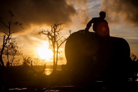 U.S. Marine Lance Cpl. Riley Remoket, with Combat Logistics Battalion 31, 31st Marine Expeditionary Unit, fills a water bull at a water distribution site during typhoon relief efforts in Saipan, Aug. 19, 2015. The Marines with Echo Company, Battalion Landing Team 2nd Battalion, 5th Marines, 31st MEU and CLB 31, 31st MEU, assisted the locals of Saipan by producing and distributing potable water. The Marines and sailors of the 31st MEU were conducting training near the Mariana Islands when they were redirected to Saipan after the island was struck by Typhoon Soudelor Aug. 2-3. (U.S. Marine Corps photo by Gunnery Sgt. Ismael Pena/Released)