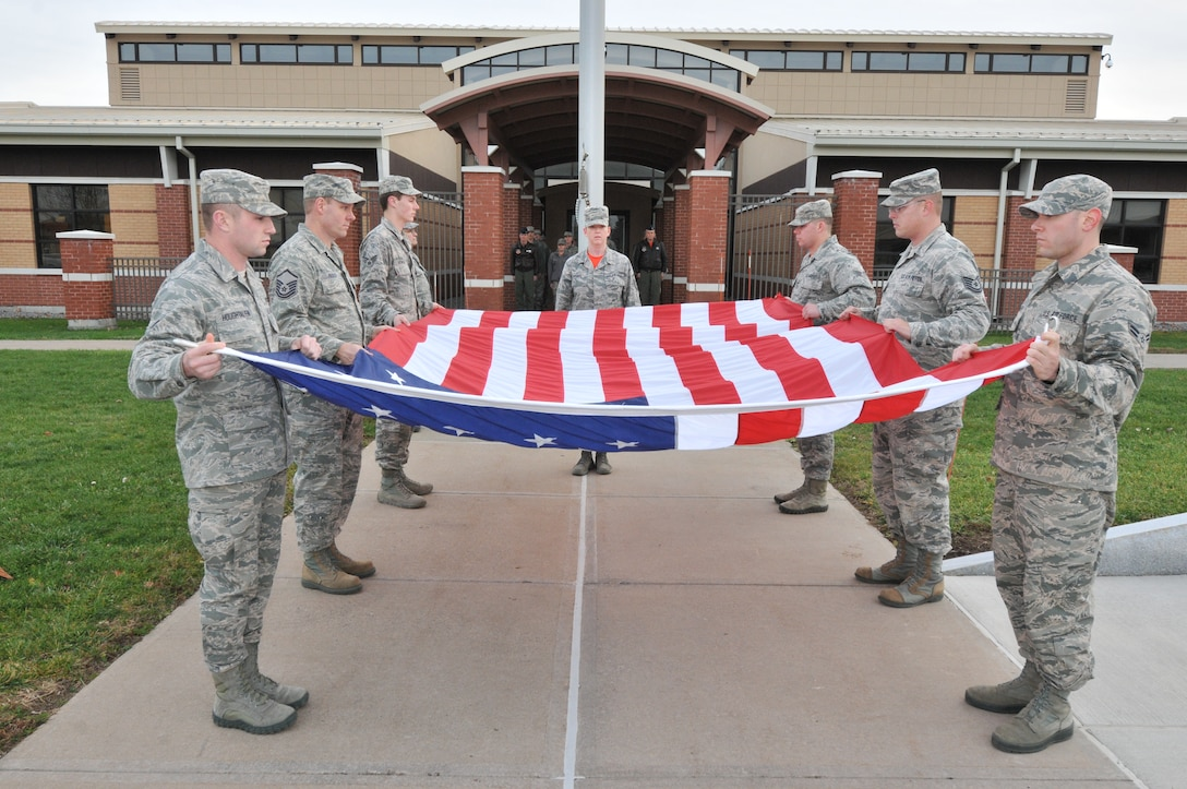 Airmen from the 152nd Air Operations Group prepare to fold the flag during a retreat ceremony at Hancock Field Air National Guard Base December 6. (U.S. Air National Guard photo by Senior Airman Duane Morgan/Released)