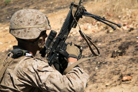 Lance Cpl. Sephen Hardy removes his magazine during a fire and movement drill at Bradshaw Field Training Area, Australia, July 15, 2015. The Marines with Golf Company, Battlalion Landing Team 2nd Battalion, 5th Marines, 31st Marine Expeditionary Unit conducted live-fire training as part of Talisman Sabre 2015. Talisman Sabre is a major bilateral exercise that enhances the combat readiness and interoperability of U.S. and Australian forces across a range of military operations. The 31st MEU participated in the exercise while deployed on its regularly scheduled Fall Patrol of the Asia-Pacific region. Hardy, a native of Evergreen, Colorado, is a machine gunner with Golf Co., BLT 2/5, 31st MEU. (U.S. Marine Corps photo by Cpl. Abbey Perria/RELEASED)