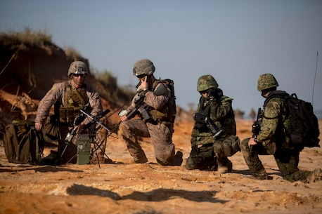 U.S. Marines with Fox Company, Battalion Landing Team 2nd Battalion, 5th Marines, 31st Marine Expeditionary Unit (MEU), and Japanese Ground Self Defense Force Soldiers from the Western Army Regiment, establish communication during an amphibious assault on stingray beach, Australia, July 11, 2015. Talisman Sabre is a major bilateral exercise that enhances the combat readiness and interoperability of U.S. and Australian forces across a range of military operations. (U.S. Marine Corps photo by Lance Cpl. Brian Bekkala/Released)