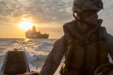 U.S. Marine Corps Lance Cpl. Chance Seckenger with Company F, Battalion Landing Team 2nd Battalion, 5th Marines, 31st Marine Expeditionary Unit (MEU), rides in a Combat Rubber Raiding Craft  during launch and recovery drills from the well deck of the USS Green Bay (LPD-20), at sea, July 9, 2015. Talisman Sabre is a major bilateral exercise that enhances the combat readiness and interoperability of U.S. and Australian forces across a range of military operations. (U.S. Marine Corps photo by Lance Cpl. Brian Bekkala/Released)
