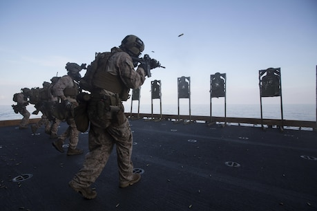 Reconnaissance Marines close with their targets while firing during a close quarters tactics training evolution aboard the USS Bonhomme Richard (LHD 6), Aug. 10, 2015. The Marines with Force Reconnaissance Platoon, Maritime Raid Force, 31st Marine Expeditionary Unit, combined fast-roping with live-fire training, all while wearing M50 gas masks. The Marines of FRP provide the 31st MEU with a specialized direct action force. The 31st MEU is currently on a regularly scheduled deployment to the Asia-Pacific region.  (U.S. Marine Corps photo by Staff Sgt. Zachary Dyer/Released)