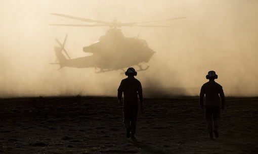 Two Marines with Marine Medium Tiltrotor Squadron 265 (Reinforced), 31st Marine Expeditionary Unit, walk out to a UH-1Y Huey as it comes in for a landing at Landing Zone Nackaroo at Bradshaw Field Training Area, Australia, July 18, 2015. The MEU's Aviation Combat Element provided close air support to the Marines on the ground during live-fire training as part of Talisman Sabre 2015. Talisman Sabre is a biennial exercise designed to improve the interoperability between Australian and U.S. forces. The 31st MEU participated in the exercise while deployed on its regularly scheduled Fall Patrol of the Asia-Pacific region. (U.S. Marine Corps photo by Staff Sgt. Zachary Dyer/Released)