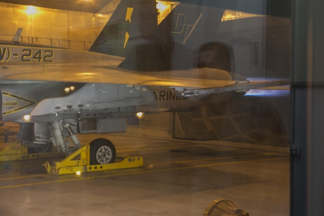 A Marine All-Weather Fighter Attack Squadron 242, VMFA(AW)-242, F/A-18D Hornet performs an engine test inside a hush house at Marine Corps Air Station Iwakuni, Japan, Dec. 14, 2015. These facilities are used to reduce noise in the local area when testing aircraft engines. Building and using facilities like these help strengthen the bond between the air station and the local community by showing that the station listens to the needs of the community and are doing their best to accommodate local citizens.