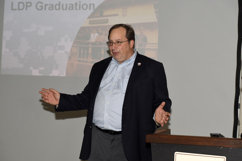 Dr. Michael Evans, founder of Evans and Associates, gives opening comments at the Leadership Development Program graduation at Scarritt Bennett Center in Nashville, Tenn., Dec. 9, 2015.  Evans, who holds a doctorate in educational leadership and behavioral sciences, instructed the one-year leadership course for 12 students from the U.S. Army Corps of Engineers Nashville District.