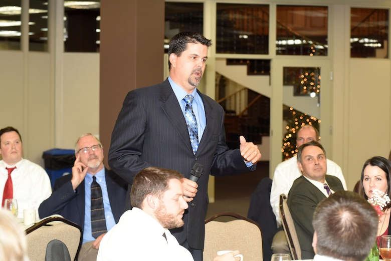 Heath Dunigan, power plant shift supervisor at Barkley Power Plant, points out several things he learned that will help him in the future during the Leadership Development Program graduation Dec. 9, 2015 at the Scarritt Bennett Center in Nashville, Tenn.