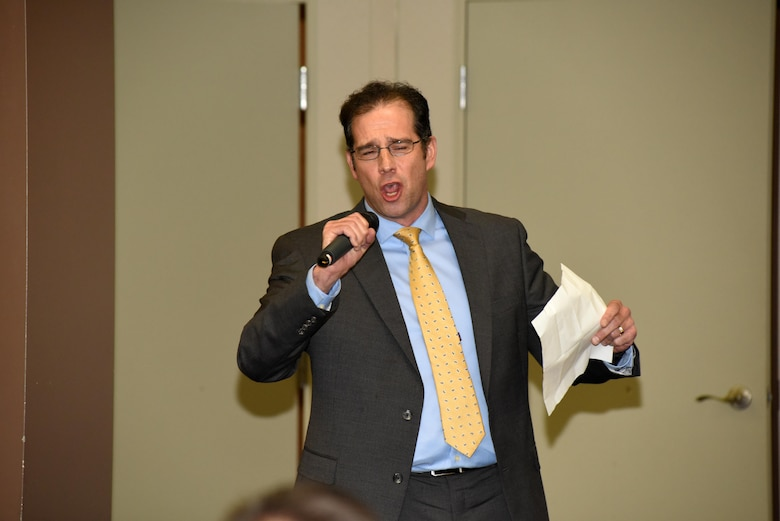 Tim Tuttle, attorney with the U.S. Army Corps of Engineers Nashville District Legal Counsel, went the extra mile and sang about his experience with the one-year leadership course during the Leadership Development Program graduation Dec. 9, 2015 at the Scarritt Bennett Center in Nashville, Tenn.