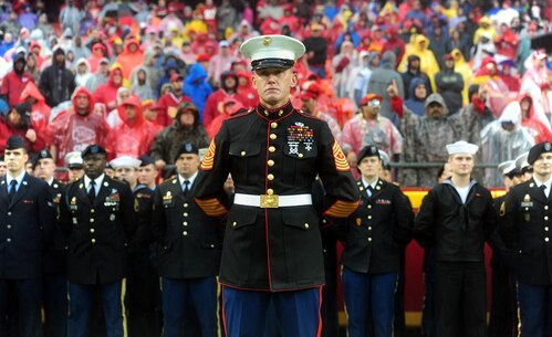 Sergeant Major Christopher A. Farrell, Marine Corps Recruiting Station Kansas City sergeant major, stands before a joint-service formation before the start of the Kansas City Chiefs' Military Appreciation Day game against the San Diego Chargers at Arrowhead Stadium, Dec. 13, 2015. Servicemembers from the Marine Corps, Army, Navy, Air Force, and Coast Guard were in attendance for the day's pregame and halftime festivities which included military vehicle static displays, joint-service color guard, and the Marine Corps Silent Drill Platoon.