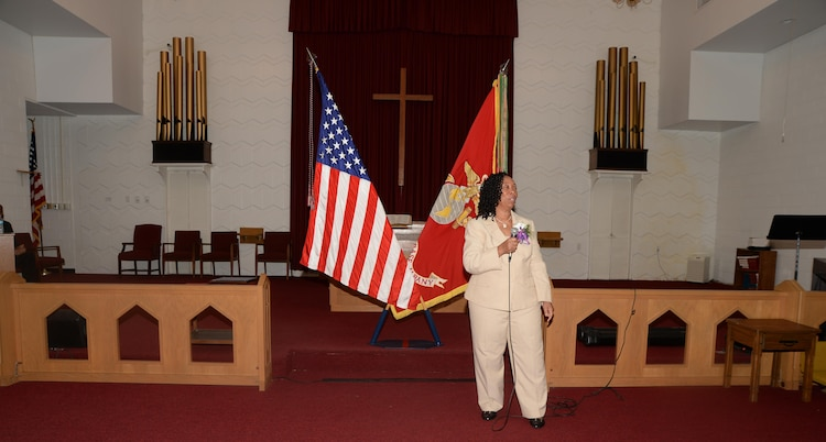 Virginia Williams, IT supervisor, Marine Corps Logistics Base Albany, speaks to the audience during her retirement ceremony, Dec. 10, in the base's Chapel of the Good Shepherd.