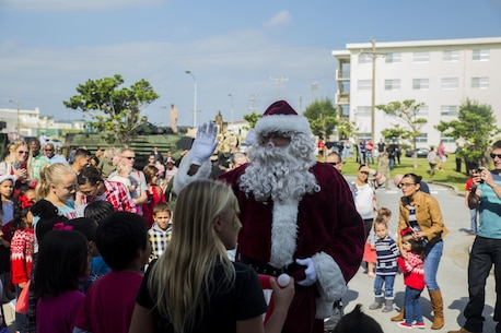 Santa Claus arrives for the event, Santa's Little Helper, on Camp Hansen, Okinawa, Japan, Dec. 12, 2015. The event also had Santa fast rope out of a helicopter, fake snow, a bouncy castle, face painting and food served. The event was hosted by Combat Assault Battalion, 3rd Marine Division, III Marine Expeditionary Force and Marine Corps Community Services. (U.S. Marine Corps photo by Cpl. Tyler S. Giguere/Released)