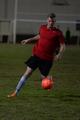 Senior Airman Michael Page, 36th Expeditionary Aircraft Maintenance Squadron, takes a shot at the ball during the intramural soccer championship Dec. 14, 2015, at Andersen Air Force Base, Guam. The 36th EAMXS Bomber Barons defeated the 36th Air Mobility Squadron Eagles after a harrowing game with a score of 3-2. (U.S. Air Force Photo/Airman 1st Class Alexa Ann Henderson)