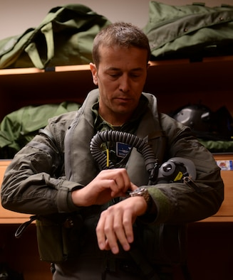 Norwegian Maj. Morten Hanche, 62nd Fighter Squadron F-35 student pilot, suits up for his historic flight of one of two Norwegian F-35s, Dec. 14, 2015, at Luke Air Force Base. Maj. Hanche is the first Norwegian to ever pilot an F-35. (U.S. Air Force photo by Airman 1st Class Ridge Shan)