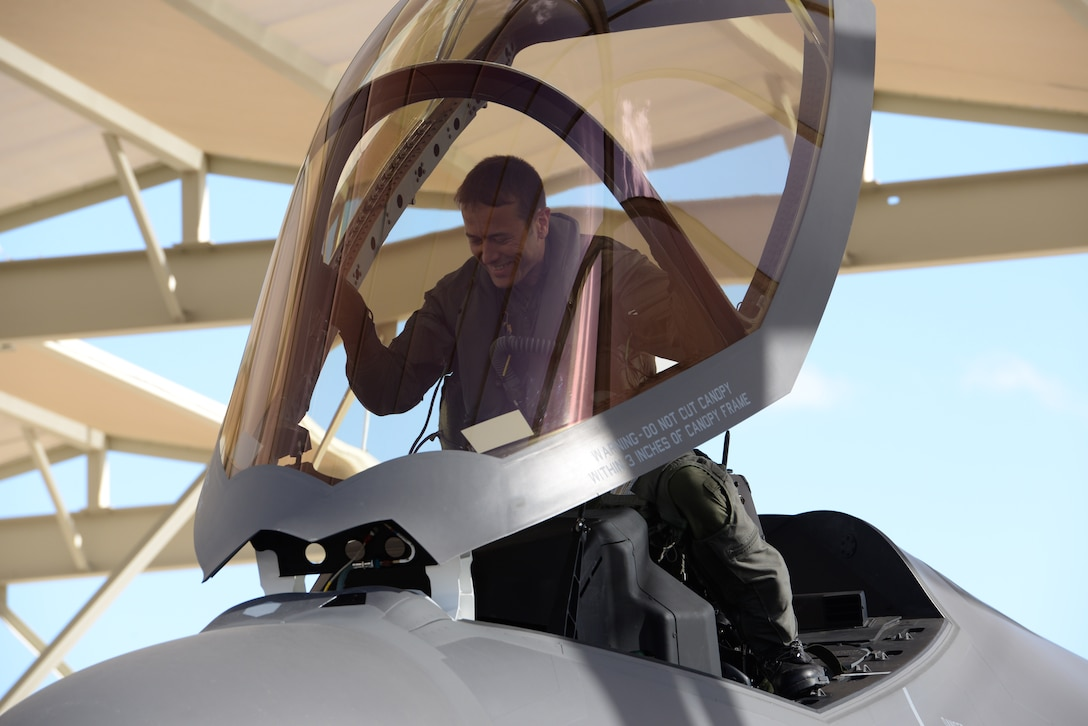 Norwegian Maj. Morten Hanche, 62nd Fighter Squadron F-35 student pilot, smiles as he enters the cockpit of a Norwegian F-35 for the first time, Dec. 14, 2015, at Luke Air Force Base. Hanche made history as the first Norwegian to ever pilot an F-35. (U.S. Air Force photo by Airman 1st Class Ridge Shan)
