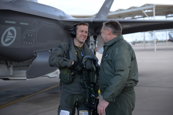 Norwegian Maj. Morten Hanche, 62nd Fighter Squadron student pilot, is congratulated by Maj. Gen. Per-Egil Rygg, Royal Norwegian air force chief of staff, after successfully completing a sortie in a Norwegian F-35, the first ever by a Norwegian pilot, Dec. 14, 2015, at Luke Air Force Base. (U.S. Air Force photo by Airman 1st Class Ridge Shan)