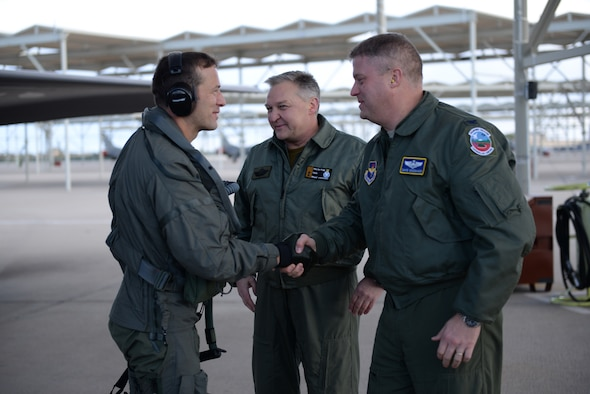 Norwegian Maj. Morten Hanche, 62nd Fighter Squadron student pilot, shakes the hand of Col. David Shoemaker, 56th Fighter Wing vice commander, in front of Maj. Gen. Per-Egil Rygg, Royal Norwegian air force chief of staff, after successfully completing a sortie in a Norwegian F-35, the first ever by a Norwegian pilot, Dec. 14, 2015, at Luke Air Force Base. (U.S. Air Force photo by Airman 1st Class Ridge Shan)