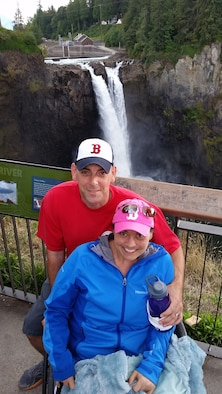 U.S. Air Force Tech. Sgt. Fred Dutton, a communications flight chief with the 5th Air Support Operations Squadron at Joint Base Lewis-McChord, Wash., is pictured with his wife, Jennifer Dutton, Sept. 5, 2015 at Snoqualmie Falls in Washington. Jennifer was diagnosed with Stage IV colon cancer in Aug. 2014. The bile drainage tube in her side, combined with chemotherapy limited her to a wheel chair until around the beginning of Nov. 2015, but the Dutton's still managed to get out and enjoy a beautiful day. (Courtesy photo)