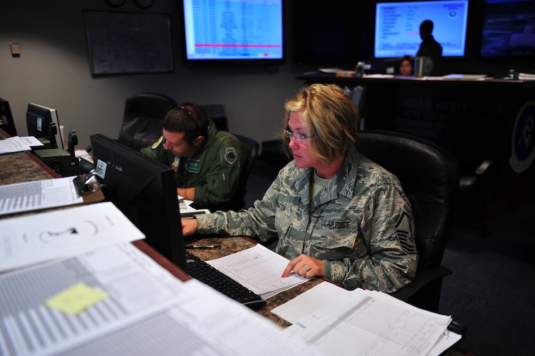 Master Sgt. Jamie Paxton, an aviation resource management specialist and Maj. Gregory Barasch, an F-16 fighter pilot, both with the 180th Fighter Wing, Ohio Air National Guard loads flight authorizations before training sorties September 16, at Tyndall Air Force Base, Florida. About 120 Airmen from the 180th FW traveled to Tyndall to participate in the Combat Archer exercise, a weapons system evaluation program designed to test the effectiveness of our Airmen and air-to-air weapon system capability of our F-16s and other combat aircraft. Training allows our pilots to provide a vital link for the defense of our country. Air National Guard photo by Senior Master Sgt. Beth Holliker/Released