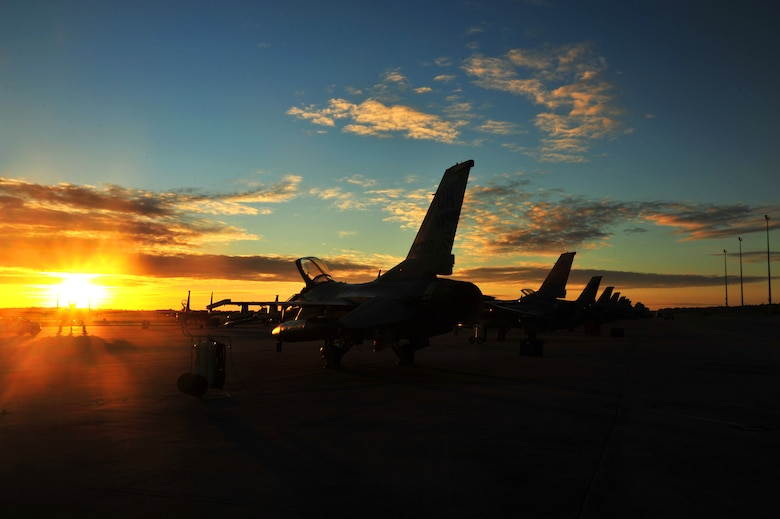 An F-16 Fighting Falcon from the 180th Fighter Wing sits on the flightline at Tyndall Air Force Base, Fla., Sept. 18, before morning sorties. About 120 Airmen from the 180th FW traveled to Tyndall Air Force Base, Fla., to participate in the Combat Archer exercise, a weapons system evaluation program designed to test the effectiveness of our Airmen and air-to-air weapon system capability of our F-16s and other combat aircraft. Training allows our pilots to provide a vital link for the defense of our country. Air National Guard photo by Senior Master Sgt. Beth Holliker/Released