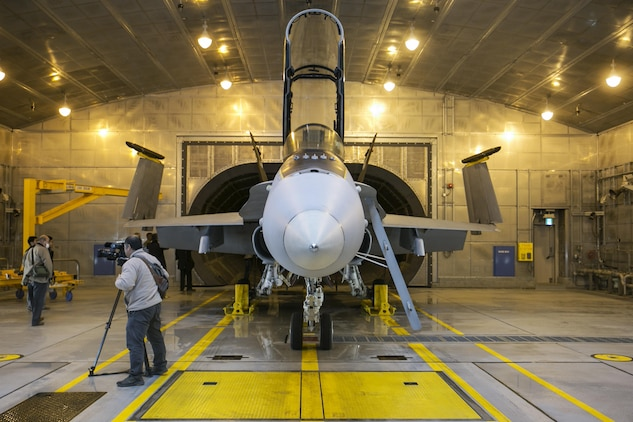Marine Aviation Logistics Squadron 12 set up a Marine All-Weather Fighter Attack Squadron 242 F/A-18D Hornet in a Hush House at Marine Corps Air Station Iwakuni, Japan, to give Japanese press from the Yamaguchi area a demonstration of an engine test Dec. 14, 2015. These facilities are used to reduce noise in the local area when testing aircraft engines. Building and using facilities like these help strengthen the bond between the air station and the local community by showing that the station listens to the needs of the community and are doing their best to accommodate local citizens.