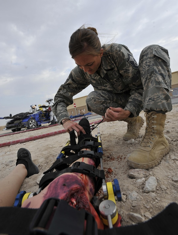 Master Sgt. Shanna Bufkin, medical technician, 340th Expeditionary Air Refueling Squadron, Al Udeid Air Base, Qatar, attends to a patient during a mass casualty exercise at Al Udeid Air Base, Qatar Dec. 15, 2015. The exercise tested the emergency response capabilities of fire and medical personnel. (U.S. Air Force photo by Master Sgt. Joshua Strang)
