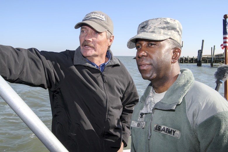 "James ""Ooker"" Eskridge (left), mayor of the town of Tangier, gives Col. Jason Kelly, commander of the Norfolk District, a boat tour around Tangier Island, on December 4. Kelly came to brief the town of a little more than 700 people on the status of district projects around their island. (U.S. Army photo/Patrick Bloodgood)"