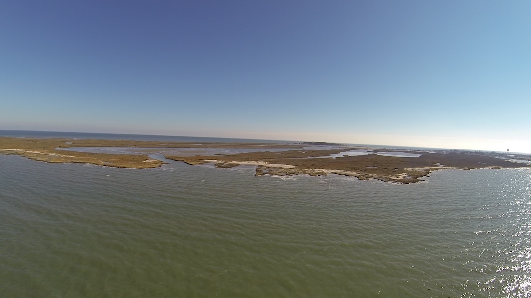 TANGIER, Va. – Aerial imagery of the Uppards portion of Tangier Island shows a breach where waters from the Chesapeake Bay flow into interior portions of the land. Each time a dredging occurs the Norfolk District, U.S. Army Corps of Engineers, uses dredged material gathered from the navigation channel at the island to help plug the breach.  (U.S. Army photo/Patrick Bloodgood)