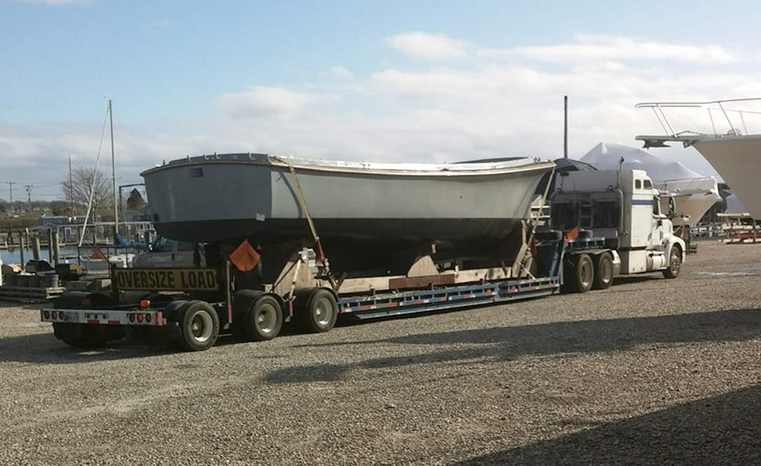 """A former Navy utility boat arrives in New London, Connecticut, via tractor-trailer Nov. 30. Two surplus boats will be used to ferry passengers between historical sites along the Thames River as part of the new """"Thames River Heritage Park"""" effort there."""