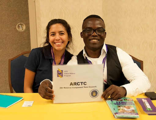 Air Reserve Component Teen Leadership Council members Biannca Recoder and Nathan Williams staff a table to inform guests at a Yellow Ribbon Reintegration event Nov. 20-22 in Orlando. The council is a nationwide group of 14 teens from Air National Guard and Air Force Reserve families. (U.S. Air Force photo by Staff Sgt. Jaimi Upthegrove)