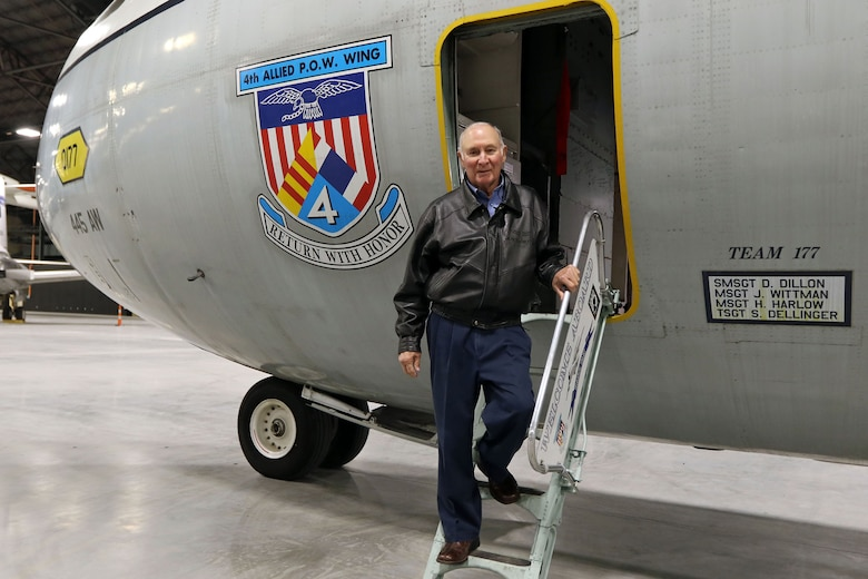 Lt. Col. (Ret.) Paul Kari, a former prisoner of war in Vietnam, poses with the Lockheed C-141C Hanoi Taxi in the new fourth building at the National Museum of the U.S. Air Force on Dec. 16, 2015. Kari was flown to freedom on the Hanoi Taxi in 1973. (U.S. Air Force photo by Don Popp)