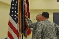 SAN ANTONIO, Texas - A change of command ceremony is an Army tradition that represents a transfer of authority from one commanding officer to another. Key to the ceremony is the senior noncommissioned officer as the custodian of the unit guidon and as the senior enlisted advisor to the incoming commander. Command Sgt. Maj. James Lambert, center, is a 30-year veteran of the Army Reserve, and is helping the unit prepare for the day's events.