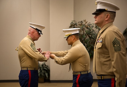 Sgt. Maj. Jeffrey Dagenhart (left), the incoming enlisted leader of Marine Corps Recruiting Station Seattle, receives the sword of office from Maj. Sung Kim, his commanding officer, during a passage of command ceremony in Seattle Dec. 12, 2015. During the ceremony, Sgt. Maj. Kent Cartmill, from Garden City, Kan., was awarded a Meritorious Service Medal and relinquished duties to Dagenhart. (U.S. Marine Corps photo by Sgt. Reece Lodder)