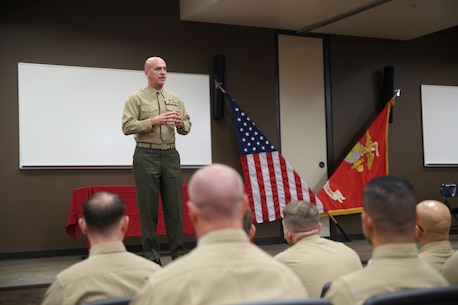 "Brig. Gen. David A. Ottignon addresses the Expeditionary Warfare School graduates during a ceremony at Marine Corps Base Camp Pendleton, Calif., Dec. 11, 2015. During his speech, Ottignon spoke about the importance of formal education to further Marines' professional development. ""Continue to seek knowledge,"" Ottignon said. ""Educate yourself as much as you can so that as an officer of Marines you can provide that scope and understanding of what's going on in the world around you."" Ottignon is the commanding general of 1st Marine Logistics Group."