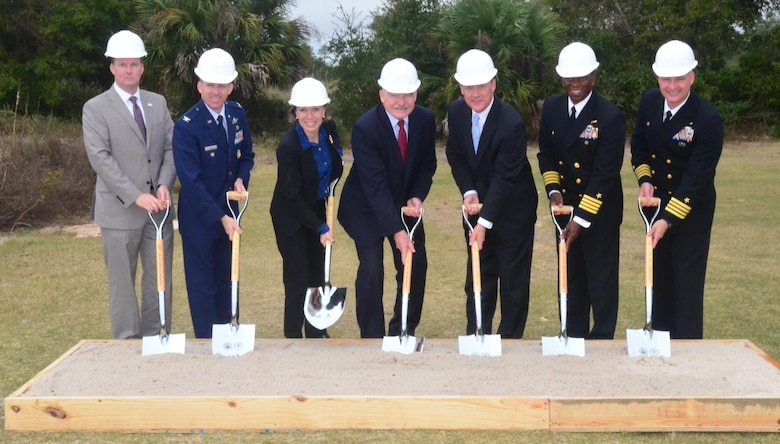 Matthew Hantzmon (left), the chief operating officer of Coronal Development; Col. Matthew W. Higer, the vice commander of the 96th Test Wing, Eglin Air Force Base, Fla.; Miranda A.A. Ballentine, the assistant secretary of the Air Force for installations, environment and energy; Dennis V. McGinn, the assistant secretary of the Navy for energy, installations and environment; Stan Connally, the president and CEO of Gulf Power; Capt. Keith W. Hoskins, the commanding officer, Naval Air Station Pensacola, Fla.; and Capt. Todd A. Bahlau, the commanding officer, NAS Whiting Field, Fla., broke ground Dec. 16, 2015, at a ceremony at NAS Pensacola, marking the start of construction for three large-scale solar electric generating facilities.  (U.S. Navy photo/Mike O'Connor)