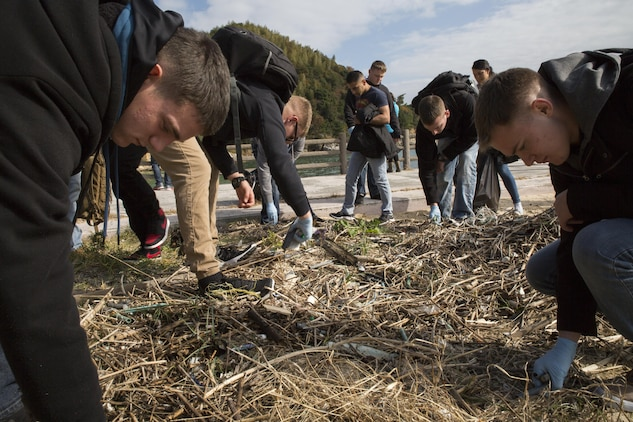 Marines and Sailors clean up Katazoe Beach on Oshima Island, Japan, during the Oshima Cleanup Dec. 12, 2015. Organized by Marine Aircraft Group 12 Chaplain's office and the Single Marine Program from Marine Corps Air Station Iwakuni, this cleanup and similar monthly community relations events help keep the local community clean as well as give service members a chance to explore Japan.