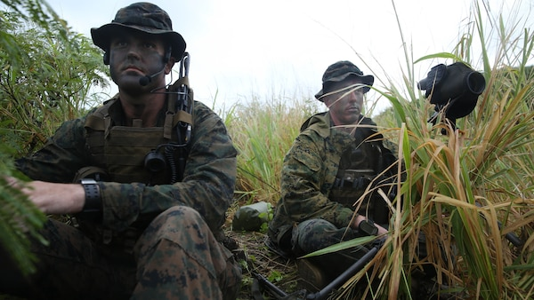 Marines with Company A, 1st Reconnaissance Battalion, 1st Marine Division, survey a named area of interest during reconnaissance and surveillance training, Nov. 19-21, 2015, aboard Marine Corps Training Area Bellows, Hawaii. The Marines conducted insertion, infiltration, execution, exfiltration, and extraction in terrain unfamiliar to what is usually found at their home base in California. The Hawaiian terrain ranged from beach shores, to dense jungle and open valleys during pouring rains
