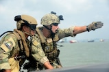 "150807-N-FN215-085 SURABAYA, Indonesia (Aug. 7, 2015) Boatswain's Mate 1st Class Kevin Diebold, right, assigned to Coastal Riverine Squadron (CRS) 3, communicates with an Indonesian ""Kopaska"" Naval Special Forces team leader while practicing interdiction techniques during Cooperation Afloat Readiness and Training (CARAT) Indonesia 2015. In its 21st year, CARAT is an annual, bilateral exercise series with the U.S. Navy, U.S. Marine Corps and the armed forces of nine partner nations. (U.S. Navy photo by Mass Communication Specialist 1st Class Joshua Scott/Released)"