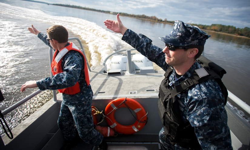 Sailors from the harbor patrol unit simulate a man-overboard exercise Dec. 9, 2015, on the Cooper River near Joint Base Charleston – Weapons Station, S.C. JB Charleston's port operations recently implemented a new training program to effectively cut down on spending and improve resourcefulness. The training consisted of putting Sailors through a series of classes. The week following their classes, they were put to the test instructing the newer Sailors on the information they just learned. (U.S. Air Force photo/Senior Airman Clayton Cupit)