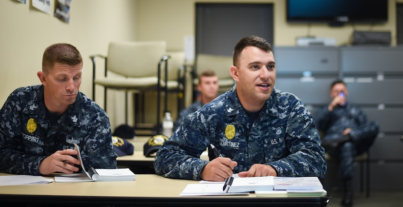 Sailors from Joint Base Charleston participate in a 'Train the Trainer' program Dec. 8, 2015, in a classroom at the security building on JB Charleston – Weapons Station, S.C. JB Charleston's port operations has recently implemented a new training program to effectively cut down on spending and improve resourcefulness. The training consisted of putting the Sailors through a series of classes. The week following their classes, the new trainers were put to the test instructing newer Sailors on the information they just learned. (U.S. Air Force photo/Senior Airman Clayton Cupit)