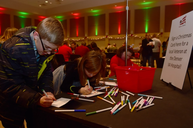 Team Buckley youth write Christmas cards for veterans at the Denver VA Hospital during Breakfast with Santa at the Leadership Development Center Dec. 12, 2015, on Buckley Air Force Base, Colo. The event provided breakfast, a gift for each child and the opportunity for a picture with Santa Claus. (U.S. Air Force photo by Airman 1st Class Luke Nowakowski/Released)