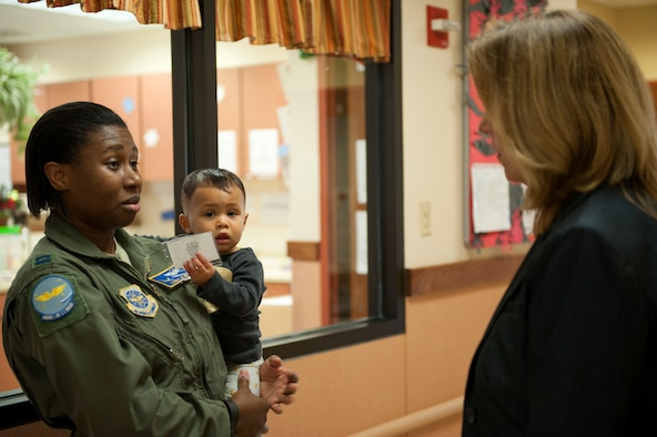 Secretary of the Air Force Deborah Lee James talks with Capt. Casey Olin, a C-130H pilot with the 19th Operations Support Squadron, about the care her daughter receives at the Child Development Center Dec. 15, 2015, on Little Rock Air Force Base, Ark. During James' first visit to Little Rock AFB, she toured the C-130 Center of Excellence, heard testimony of the personnel programs available and witnessed how combat airlift is conducted.
