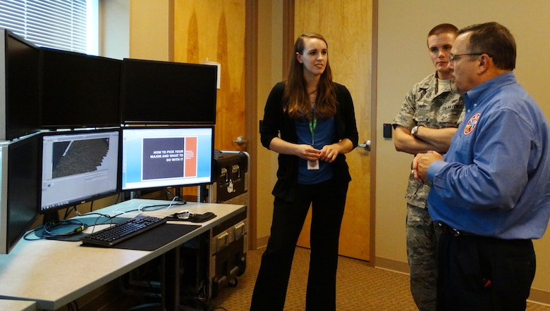 Carly Rolfes, a former GRILL intern, discusses her project with Dr. Winston Bennett and then-1st Lt. Ben Davis. (U.S. Air Force photo)