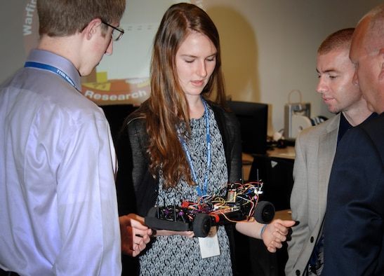 Kathleen Clark and Leland Merling, both former interns in the Wright Scholars program, practice their technical communication skills by presenting their project to local school administrators. (U.S. Air Force photo)