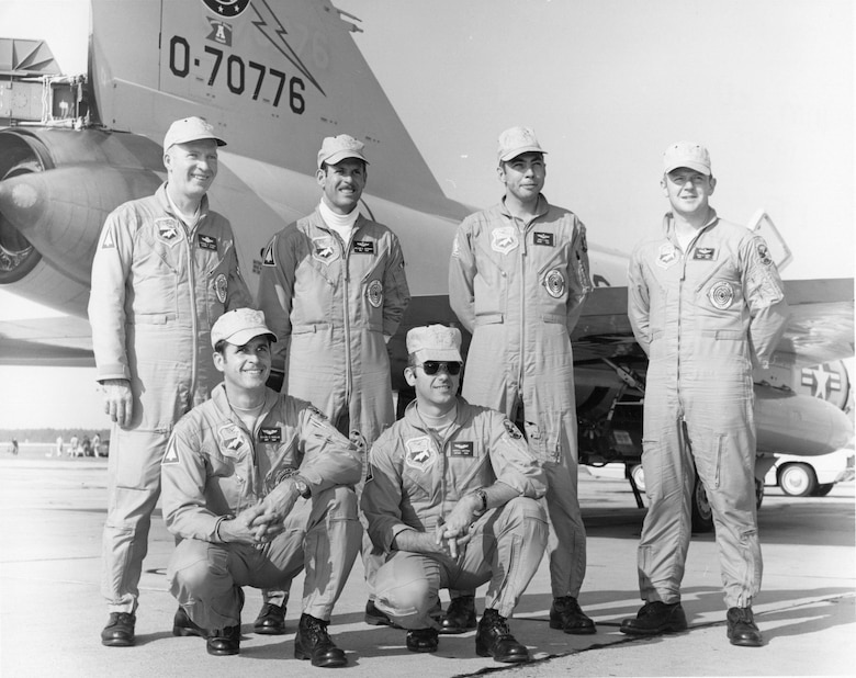 Pilots of the Oregon ANG's 142nd Fighter Group William Tell 1970 team pose for a photo by the group commander's F-102 Delta Dagger fighter-interceptor.  Standing, from left to right, are 142nd FG Commander Colonel Patrick E. O'Grady, Major William B. McDonald, Major Jimmy K. Angel and Captain Robert M. Parker.  Kneeling, left to right, are Captain Michael E. Ranslam and Captain Harold L. Hoffman.  (142nd Fighter Wing History Archives)